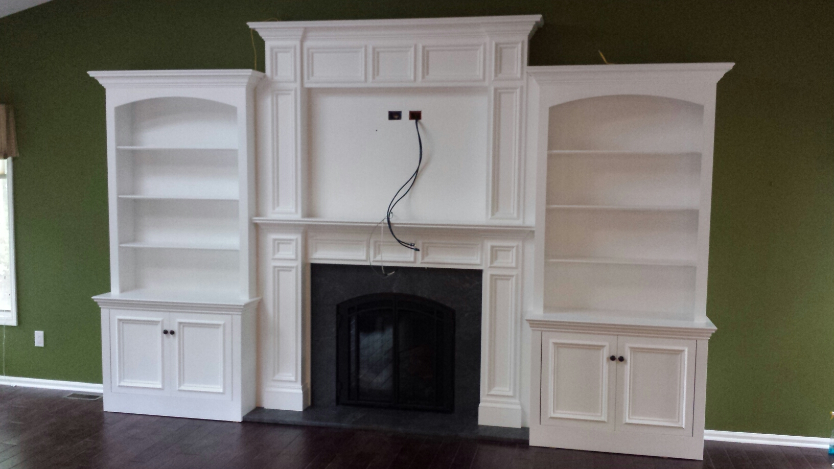 Gas Fireplace w/ custom Woodwork Built-in's