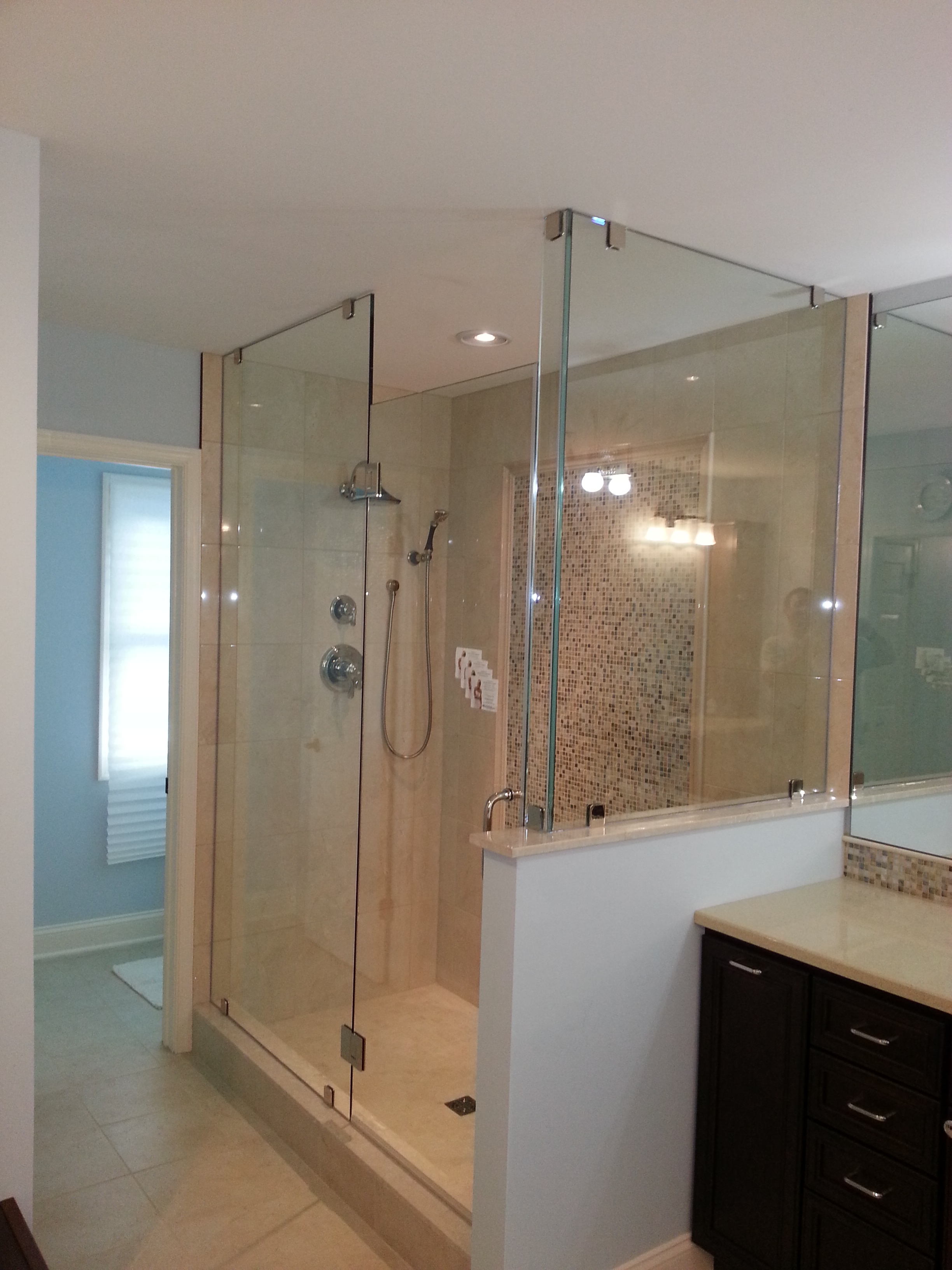 Glass Shower Enclosure in Refinished Bathroom