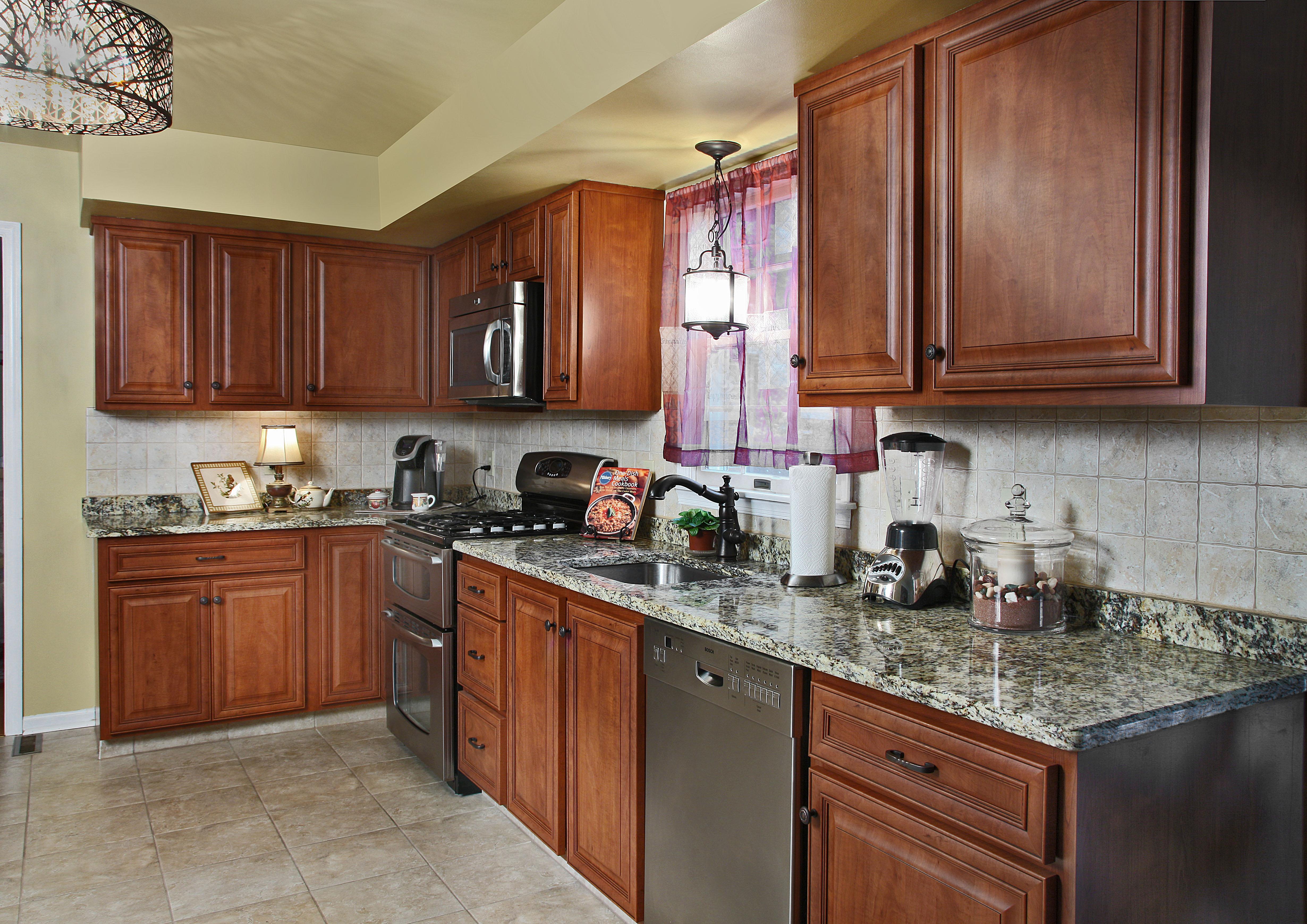 Classic Cherry and Granite countertops Kitchen Magic House